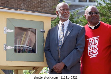 Philadelphia, PA/USA - June 7, 2018: State Senator Art Haywood (left) is joined by Rev. Chester Williams for the dedication of a new pocket park and Little Free Library in Northwest Philadelphia.