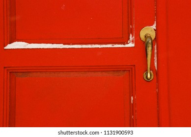 Philadelphia, PA/USA-December, 2001. Red door with snow.