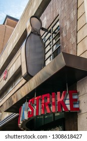 Philadelphia, Pennsylvania - February 5, 2019: Bowling pin sign over the doorway entrance for the Lucky Strike Bowling Alley in center city, Philadelphia as seen on this date