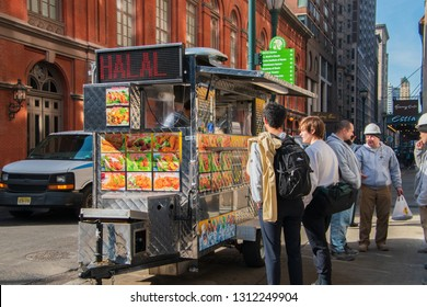 Philadelphia, Pennsylvania - February 5, 2019: Customers are seen along side a food cart selling Halal food on Broad Street near the Academy of Music on this date