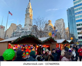 Philadelphia, Pennsylvania - November 29, 2019: Holiday shoppers browse vendor stalls for gifts, ornaments, specialty items and food at the Philadelphia Christmas Market in Love Park.