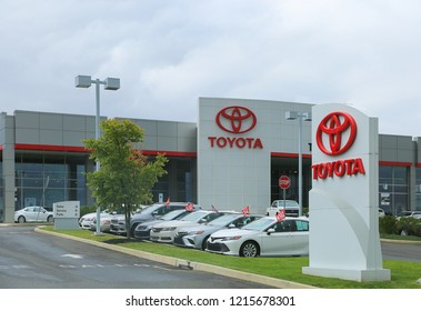 Philadelphia, Pennsylvania October 28, 2018:  Toyota dealership sign against blue sky. Toyota is the world's market leader in sales of hybrid electric vehicles.