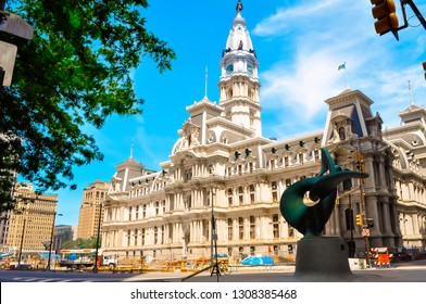 Philadelphia, Pennsylvania / USA - 05 26 2014: Philadelphia's city hall at Broad street downtown. Philly's famous city center with governmental buildings on a sunny summer day.