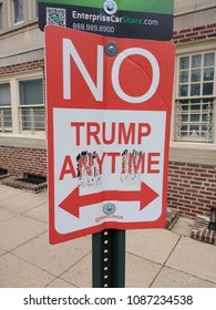 """Philadelphia, Pennsylvania / USA - April 06 2018: A play on the street sign, """"No Parking Anytime,"""" this sign humorously denounces President Trump with the words, """"No Trump Anytime""""."""