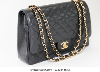 Philadelphia, Pennsylvania, USA, August 10, 2018: Photo of black Chanel handbag brand Editorial on white background.