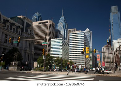 Philadelphia, Pennsylvania, USA – August 3, 2016: Panoramic view of Philly skyline from Broad St with JF Kennedy Bl crosswalk