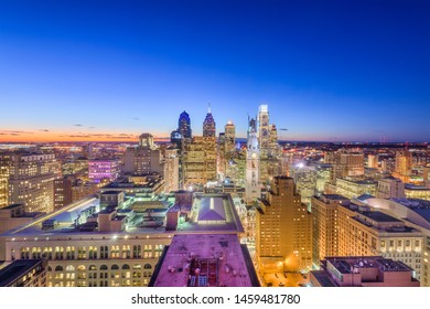 Philadelphia, Pennsylvania, USA downtown city skyline rooftop view at dusk.