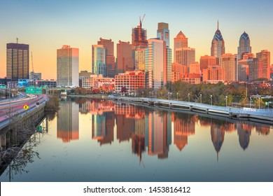 Philadelphia, Pennsylvania, USA downtown skyline at dusk on the Schuylkill River.