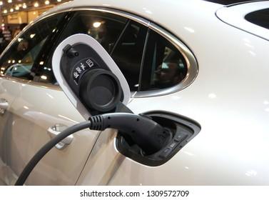 Philadelphia, Pennsylvania, U.S.A - February 10, 2019 - Electric charging port of a white 2019 Porsche Panamera Turbo Hybrid car
