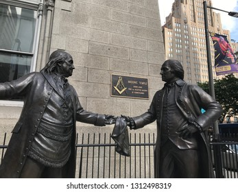 Philadelphia Pennsylvania USA - May 30 2018: Statue of Benjamin Franklin and George Washington in front of the Masonic Temple in Philadelphia - headquarters of the Grand Lodge of Pennsylvania