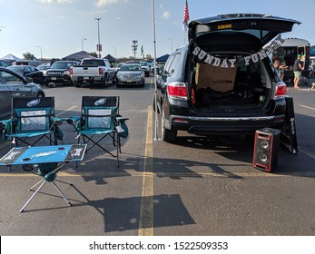 "Philadelphia, Pennsylvania / USA - September 22, 2019: Philadelphia Eagles Tailgate Setup in Parking Lot with Chairs, Table, and Speaker with ""Sunday Funday"" Banner"