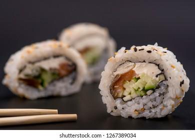 Philadelphia roll sushi with salmon, prawn, avocado, cream cheese. Sushi menu. Japanese food.