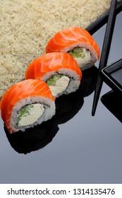 Philadelphia roll sushi with salmon, prawn, avocado, cream cheese. Sushi menu. Japanese food. copy space