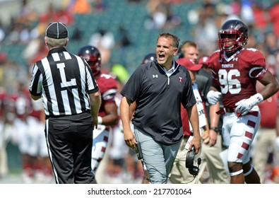 PHILADELPHIA - SEPTEMBER 6: Temple Owls head coach Matt Rhule (black shirt) shown in a NCAA football game between Temple and Navy September 6, 2014 in Philadelphia.