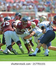 PHILADELPHIA - SEPTEMBER 6: Temple Owls running back Jamie Gilmore #26tries to squeeze through a gap in the line during a NCAA football game between Temple and Navy September 6, 2014 in Philadelphia.