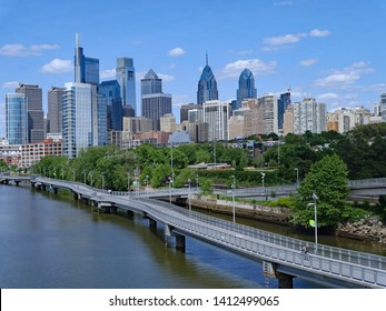 Philadelphia skyline in 2019 with recreational boardwalk along the Schuylkill River, known as the Schuylkill Banks