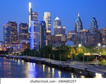 Philadelphia skyline at dusk with the Schuylkill River on the foreground, USA
