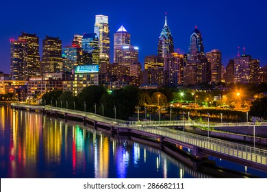 The Philadelphia skyline and Schuylkill River at night, seen from the South Street Bridge in Philadelphia, Pennsylvania.