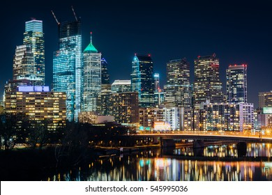 The Philadelphia skyline and Schuylkill River at night, in Philadelphia, Pennsylvania.