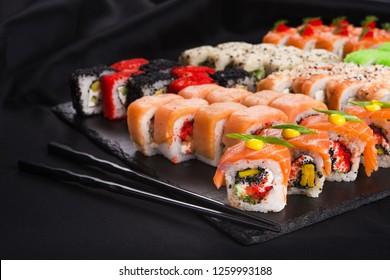 philadelphia sushi with salmon on a black background. Japanese food.