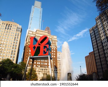 Philadelphia, United States - October 12, 2010: Love sculpture close up , with water fountain spray, the skyscrapers and blue sky in the background.