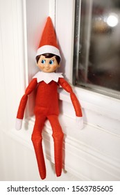 PHILADELPHIA, USA - 28 OCTOBER 2018:Funny Christmas toy the Elf on the Shelf on window. American christmas traditions. Xmas activities for family with kids.