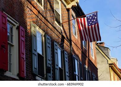 Philadelphia, USA - February 8, 2016: The Stars and Stripes at Elfreth's Alley in Philadelphia on February 8, 2016.
