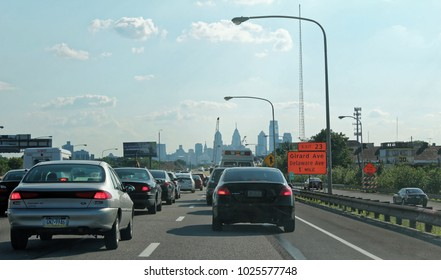 Philadelphia, USA - July 18, 2014: Road on interstate highway 95 with cars and traffic and cityscape or skyline of downtown