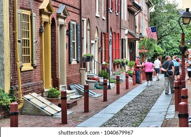 PHILADELPHIA, USA - JUNE 11, 2013: People visit Elfreth's Alley in Philadelphia. The alley is a National Historic Landmark. It dates back to 1702.