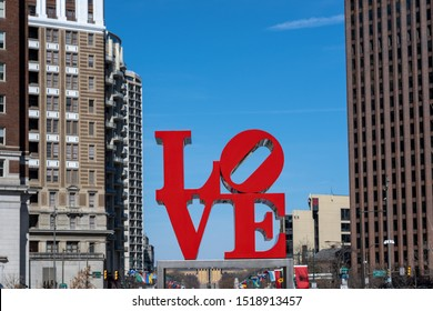 PHILADELPHIA, USA - MAR 2019 : Closeup Love park charactor over the modern building in Philadelphia on March 24, 2019. USA, Love Park, officially known as John F. Kennedy Plaza located in Center City