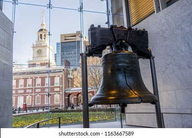 PHILADELPHIA, USA - MARCH 11, 2018: Liberty Bell and Independence Hall background in Philadelphia