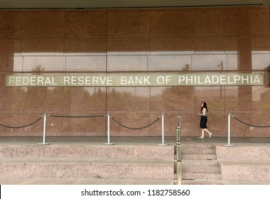 Philadelphia, USA - May 29, 2018: Woman near the Federal Reserve Bank of Philadelphia, also known as the Philadelphia Fed and the Philly Fed.