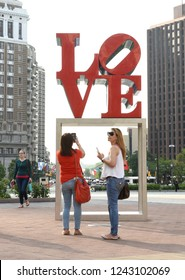 Philadelphia, USA - May 29, 2018: People near the Love statue in Love Park in downtown of Philadelphia, PA, USA