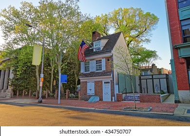 Philadelphia, USA - May 4, 2015: Betsy Ross house and Hanging American Flag in Philadelphia, Pennsylvania, USA. This is a house of the woman who first created the American Flag.