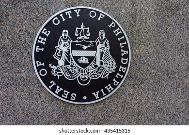 Philadelphia, USA - May 5, 2015: Seal of the City of Philadelphia ground marker. It is a ground marker on the pavement in the Center of Philadelphia, Pennsylvania, USA.