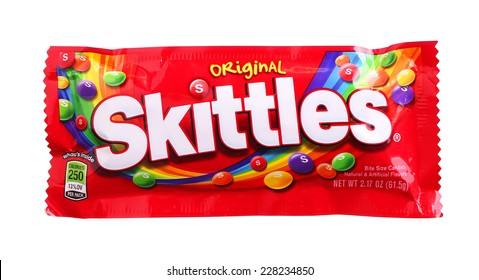 PHILADELPHIA, USA - OCTOBER 30, 2014: Closeup of Skittles candy made by Wm. Wrigley Jr. Company isolated on white background