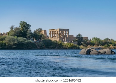Philae temple and island in the reservoir of the Aswan Low Dam, downstream of the Aswan Dam and Lake Nasser, Egypt. Philae was originally located near the expansive First Cataract of the Nile in Upper