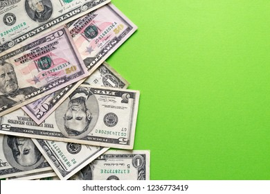 Philanthropist concept - dollars banknotes on green background. Copy space for text. Exchange rates in bank. ?harity for nature protection.
