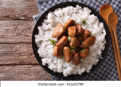 Philippine Adobo chicken with rice on a plate horizontal view from above