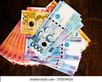 Philippine currency of various denominations laid out on a table