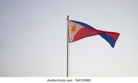 The Philippine flag on a clear, windy day