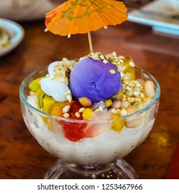 Philippine 'Halo Halo' - Dessert consisting of shaved ice and milk along with various ingredients, including boiled sweet beans, coconut, sago, gulaman (agar jelly), tubers and fruits.