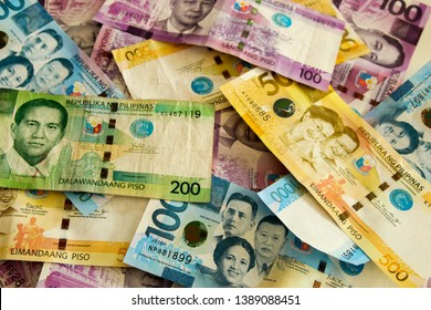 Philippine pesos with other bills in the background