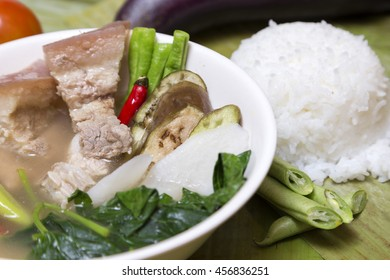 Philippine traditional dish: Sinagang pork soup with vegetables and rice