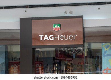 Philippines, 22 March 2018 - Tag Heuer brand name on store entrance in shopping mall. Expensive watch store label. Swiss watches shop. Fashion accessories storefront. Watch shop label closeup photo