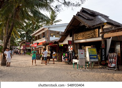 Philippines, Boracay Island - 21 May 2013: Local shops and bars on restaurant-lined white beach