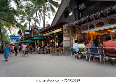 Philippines, Boracay Island - 21 May 2013: Local shops and bars on restaurant-lined white beach.