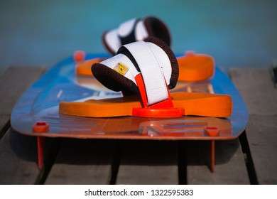 PHILIPPINES, BORACAY ISLAND. BULAGOG BEACH - January 01 2019: Kitesurfing board lying on the wooden table and blurred sea background. Watersports equipment