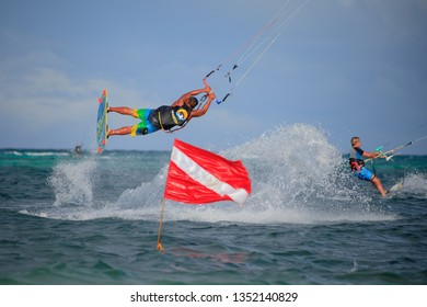 PHILIPPINES, BORACAY ISLAND, BULLABOG BEACH- January 01 2019: Kiter athlete performing freestyle raley  jump over the red flag on kiteboard. Extreme water sport