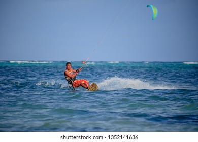 PHILIPPINES, BORACAY ISLAND, BULLABOG BEACH- January 01 2019: Asian male riding kite on high speed